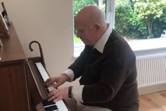 Paul Harvey, who has dementia, plays a piece he composed in the 1980s on the piano