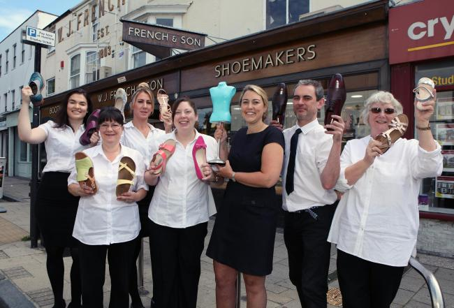 Caroline French and staff at W.J. French & Son celebrate being crowned independent footwear retailer of the year.