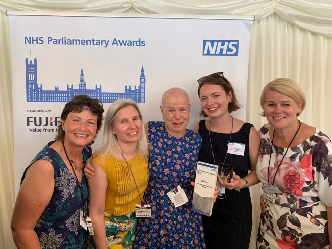 Pamela Campbell winning the Lifetime Achievement Award alongside her daughter and Solent NHS staff.