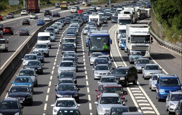 Traffic on the M27 motorway. Stock image.