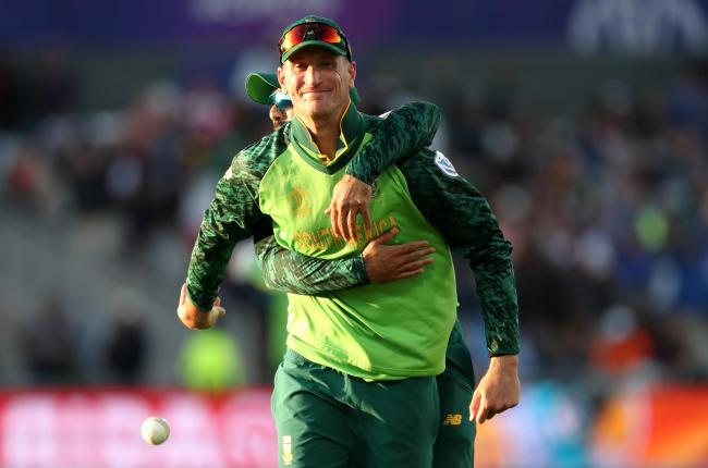 South Africa's Chris Morris celebrates dismissing Australia's David Warner during the ICC Cricket World Cup group stage match at Emirates Old Trafford, Manchester. PRESS ASSOCIATION Photo. Picture date: Saturday July 6, 2019. See PA story CRICKET