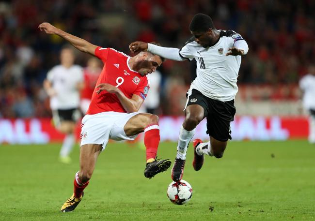 Kevin Danso (right) in action for Austria against Wales