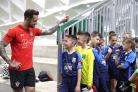 Danny Ings meets Redbridge Wanderers players. Picture provided by Virgin Media.