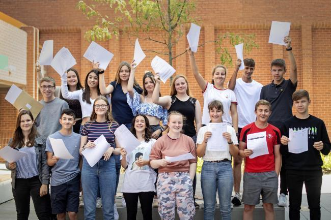 Nine sets of twins at the same school are celebrating after gaining more than 360 GCSEs between them.