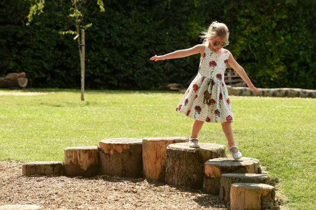 A girl enjoys the wild play site at Stanford Rise Green in Sway.