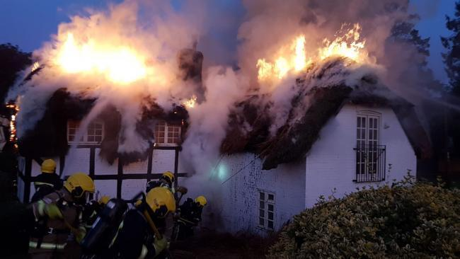 Firefighters tackle a thatch blaze near Alresford. Picture by Hampshire Fire and Rescue.