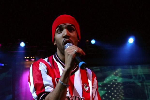 R'n'B singer Craig David wears a Southampton football shirt, while performing on stage at the Royal Albert Hall in London, Thursday 1 May 2003. PA Photo : Yui Mok.