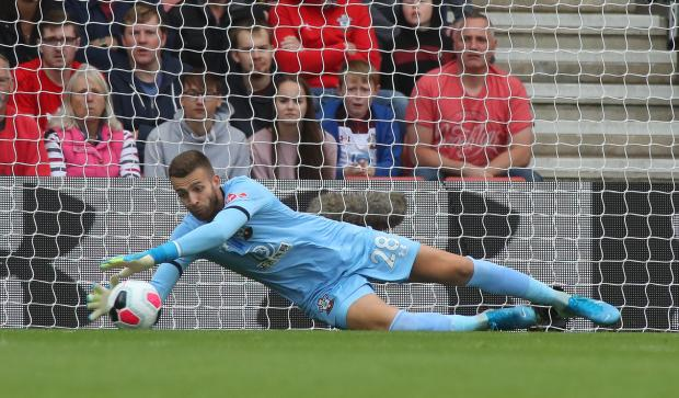 Daily Echo: Angus Gunn will be disappointed with his performance at St Mary's on Sunday