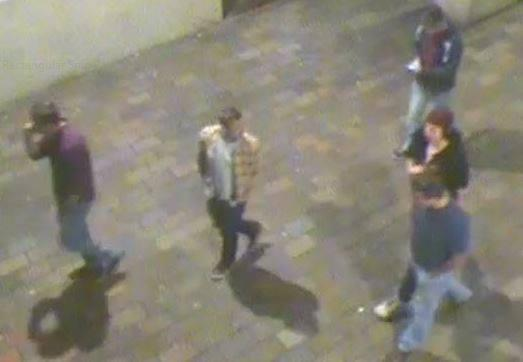 Police are trying to trace five men in connection with the assault