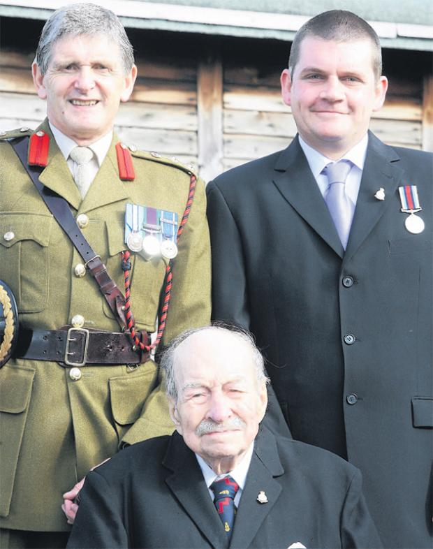 Daily Echo: Colonel Terry Scriven, left, presented the HM Armed Forces Veterans Badge to the oldest veteran, 92- year-old Bert Thomas, and the youngest, 33- year-old David Miller.