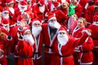 PHOTOS: Hundreds don red suits for Winchester's Santa Fun Run