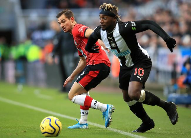 Southampton's Cedric Soares (left) and Newcastle United's Allan Saint-Maximin battle for the ball during the Premier League match at St James' Park, Newcastle. PA Photo. Picture date: Sunday December 8, 2019. See PA story SOCCER Newcastle. Pho