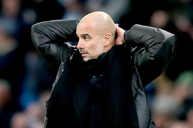 Pep Guardiola looks on during Saturday's derby defeat and knows the game is up