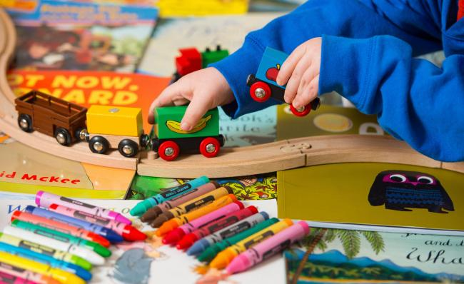 Generic stock photo shows a toddler playing with a selection of children's toys, including wooden building blocks, crayons and a train set. PRESS ASSOCIATION Photo. Picture date: Tuesday January 27, 2015. Photo credit should read: Dominic Lipinski/PA