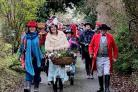 Natascha Kenyon, Michelle Lomas and Gordon Rimes lead the Wassail procession in Avebury