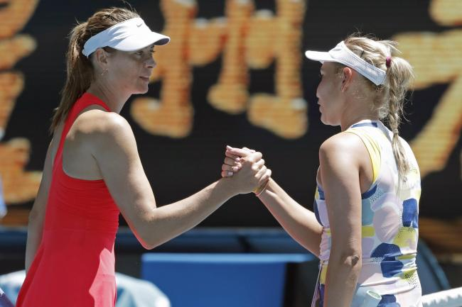 Maria Sharapova, left, shakes hands with Donna Vekic after losing in the first round in Melbourne