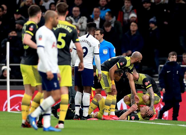 James Ward-Prowse receives treatment on the pitch at White Hart Lane
