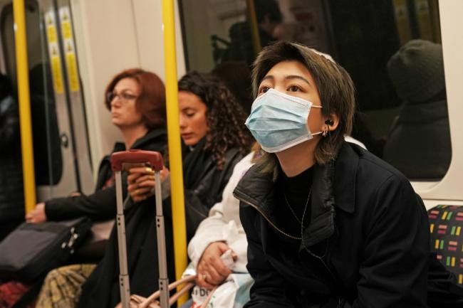 A woman wearing a mask on the London Underground. Pic. PA