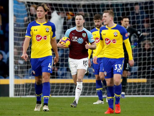 Burnley's Ashley Barnes (centre) collects the ball after scoring his side's first goal of the game from the penalty spot during the Premier League match at Turf Moor, Burnley.