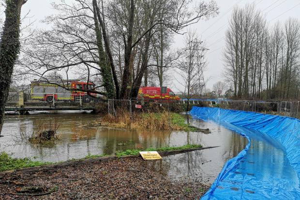 Hampshire Fire and Rescue Services set up flood barriers in Romsey