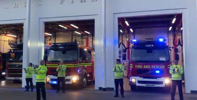 Firefights at St Mary's clap for carers. By: St Mary's Fire Station