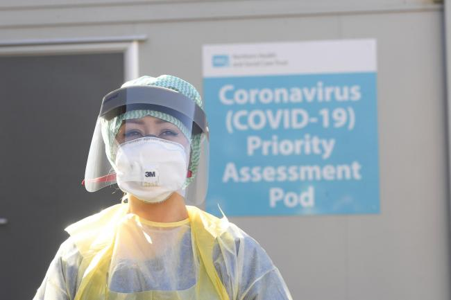 Stock image of a healthcare worker wearing PPE.