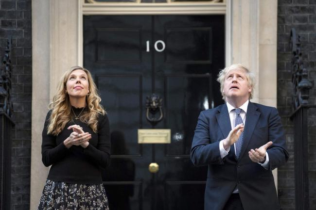 Prime Minister Boris Johnson and Carrie Symonds stand in Downing Street, London, to join in the applause during Thursday's nationwide Clap for Carers. Photo credit should read: Victoria Jones/PA Wire.