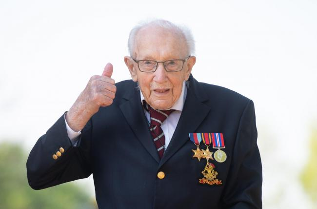 File photo dated 16/04/20 of Captain Tom Moore, at his home in Marston Moretaine, Bedfordshire. The Second World War veteran and NHS fundraiser is to be knighted Downing Street has announced. PA Photo. Issue date: Wednesday May 20, 2020. The 100-year-old