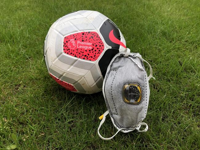 A Premier League Football is dressed with a PPE face mask (Pic: Matthew Vincent/PA Wire)