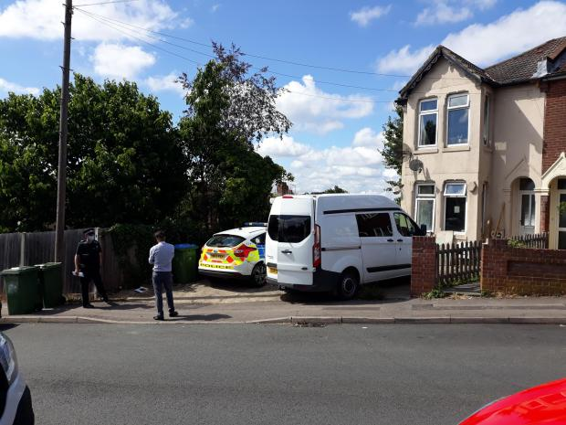 Daily Echo: Police officers in Bond Road, Southampton following a firearms raid