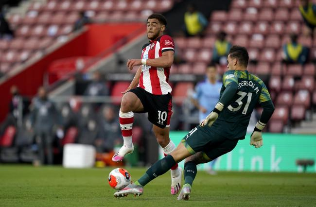 Che Adams in action against Man City
