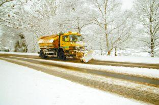 Daily Echo: A gritter at work during the worst of the snow fall