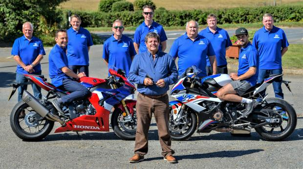 Daily Echo: Foreground, Isle of Wight Council leader, Cllr David Stewart, with the Diamond Races team, from left, Neil Tuxworth, Steve Plater (on bike), Eddie Forster-Knight, James Kaye, Matt Neal, Paul Sandford, William Parry, James Hillier (on bike), and Gary Thompson.