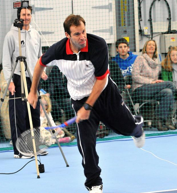 Daily Echo: Former world No 4 Greg Rusedski tests out his serve against the speed gun while officially opening Ilkley Lawn Tennis & Squash Club's refurbished indoor courts