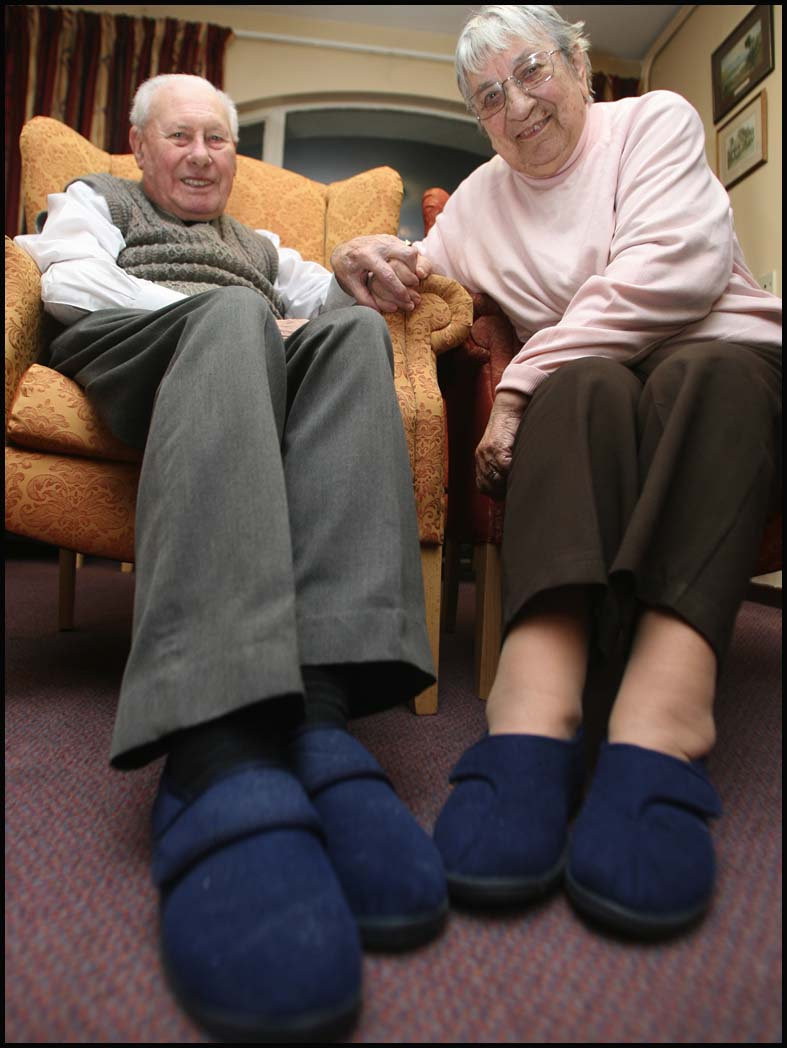 Elsie and Ted Dixon in their slippers at Ironside Court residential home, Southampton.