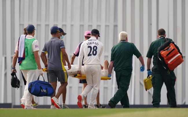 Hampshire's Liam Dawson leaves the game on a stretcher after picking up an injury during day two of The Bob Willis Trophy match at Radlett Cricket Club, Radlett (Picture: PA)