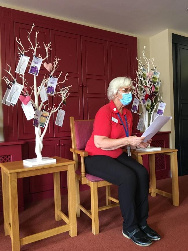 A team member reading a Celebration of Life poem to residents at Colten Care's Linden House dementia care home in Lymington.