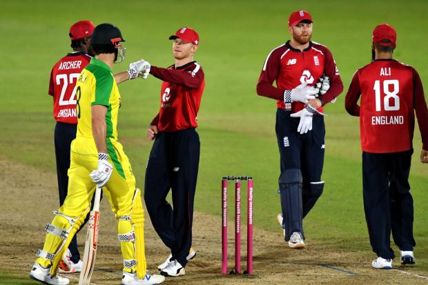 Australia's Mitchell Marsh (left) fist bumps England's Sam Billings after the third Vitality IT20 match at the Ageas Bowl, Southampton. PA Photo. Picture date: Tuesday September 8, 2020. See PA story CRICKET England. Photo credit should read: Glyn