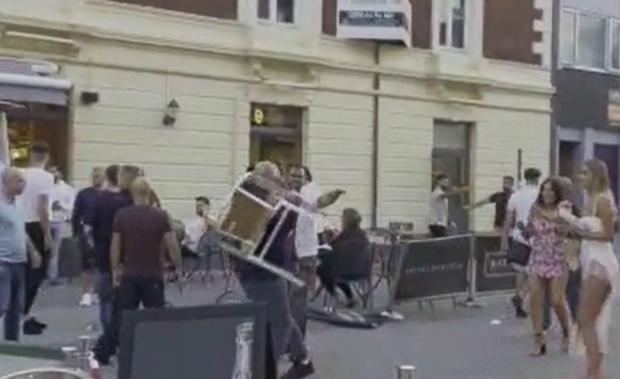 Daily Echo: A man picks up a chair in Oxford Street, Southampton
