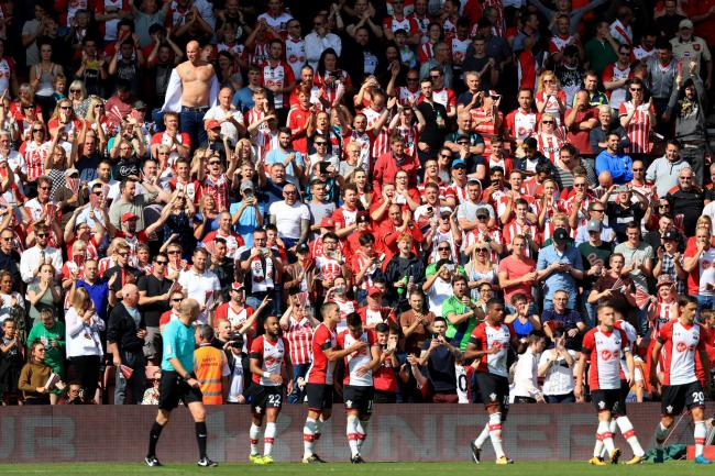 Southampton fans celebrate their side's second goal scored from the penalty spot by Dusan Tadic during the Premier League match at St Mary's, Southampton. PRESS ASSOCIATION Photo. Picture date: Saturday August 19, 2017. See PA story SOCCER Southam
