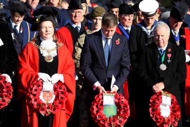 Mayor of Winchester, Cllr Jane Rutter; Steve Brine MP; and the chairman of Hampshire County Council, Cllr Keith Chapman. Remembrance service at the war memorial, Winchester Cathedral. Photo: Chris Moorhouse. November 13 2016