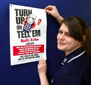 Senior sister Shelley French puts a poster up in Southampton General Hospital's eye unit.