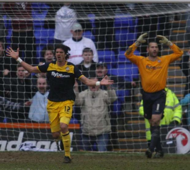 Jose Fonte and Kelvin Davies despair as Tranmere are awarded a penalty