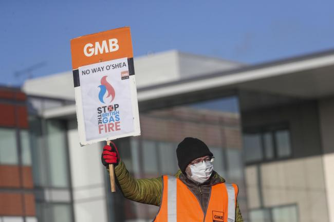 A British Gas worker outside the headquarters of Centrica in Windsor, Berkshire, on the first of a seven day strike over new contracts. Picture date: Friday January 22, 2021..