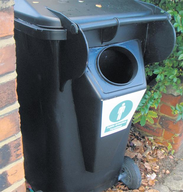 A wheelie bin with urinal