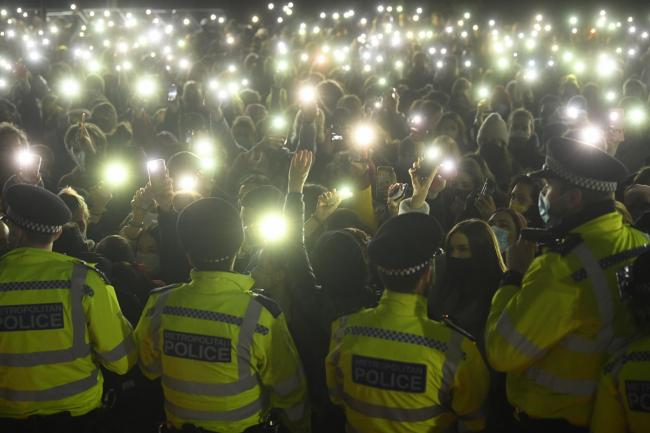 People in the crowd turn on their phone torches in Clapham Common, London, , after the Reclaim These Streets vigil for Sarah Everard was officially cancelled. Serving police constable Wayne Couzens, 48, has appeared in court charged with kidnapping and