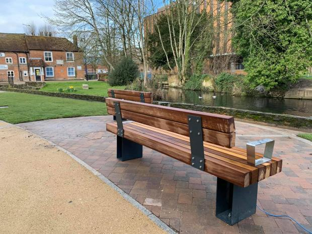 A bench overlooks the river in Andover