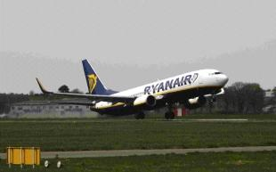 Daily Echo: ON THE RUNWAY: A Ryanair flight is the first to take off from Bournemouth Airport