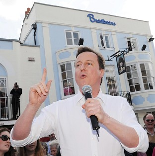 Cameron heckled on visit to key marginal