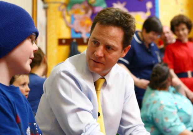 Nick Clegg chats with 11-year-old Paul Harrison on a visit to the children's cancer ward